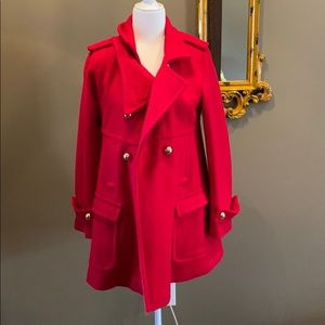 Red peacoat.